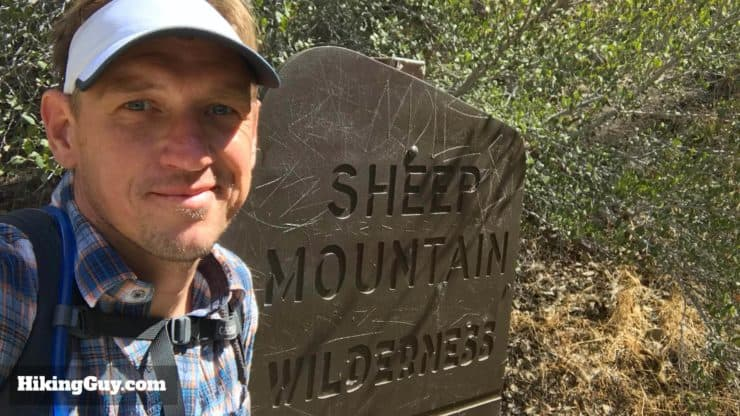 Cris Hazzard With Sheep Mountain Wilderness Sign