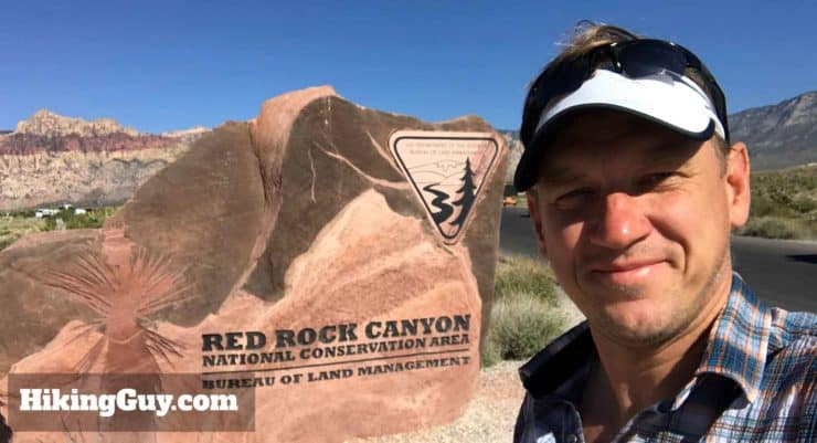 Cris Hazzard With Red Rock Sign