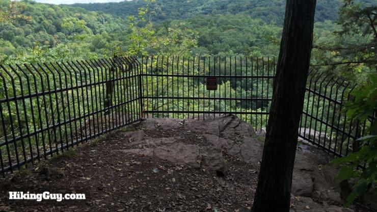 fence on high rocks hike