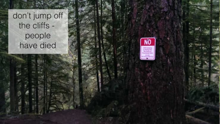 signs warning against jumping off of Punchbowl Falls